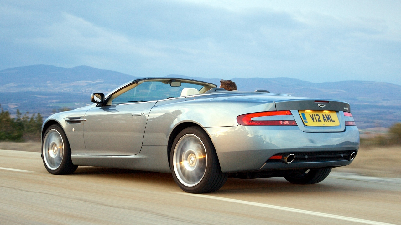 Preview wallpaper 2004, aston martin, cars, db9, gray, mountains, side view, speed, style