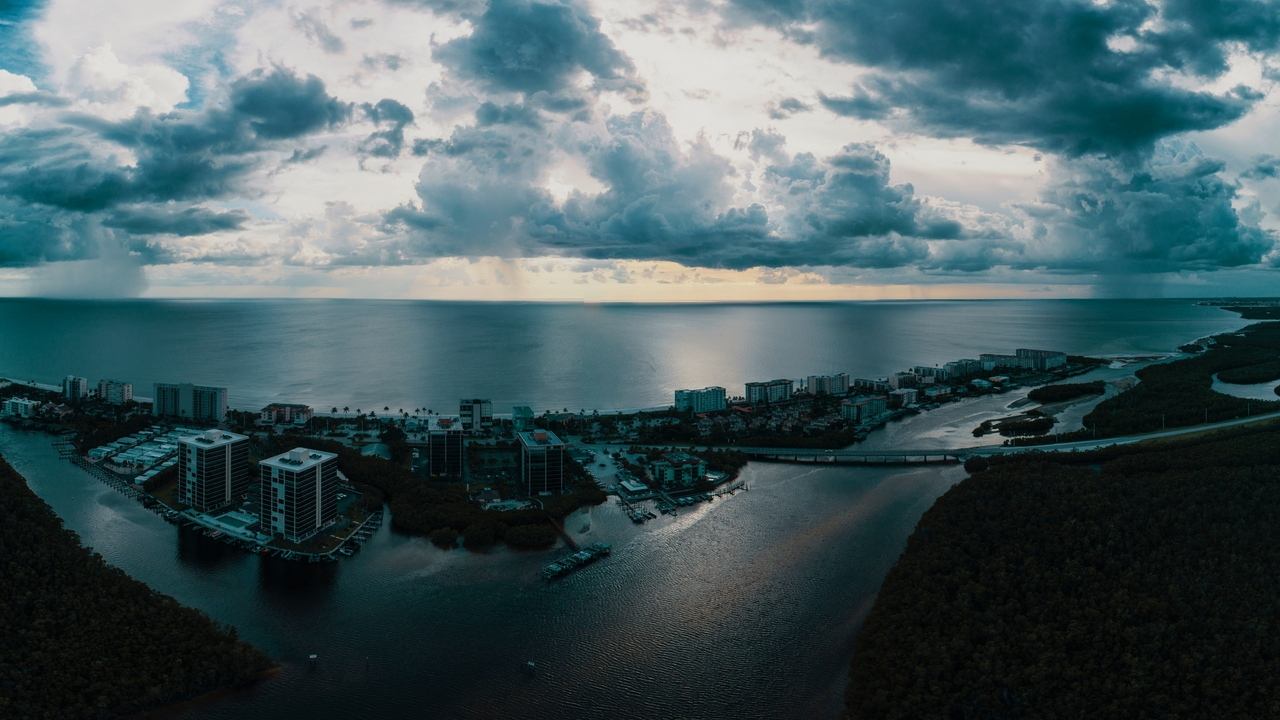 Preview wallpaper aerial view, city, clouds, island, ocean, sea, twilight