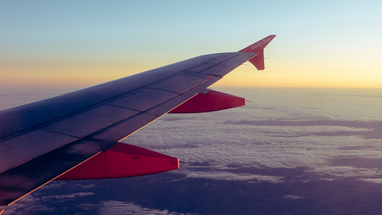 Preview wallpaper airplane, clouds, overview, porthole, wing