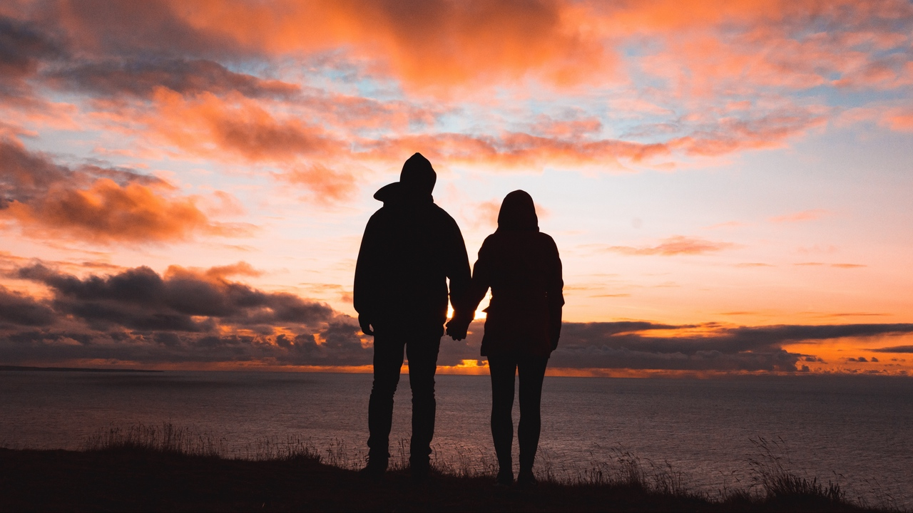 Preview wallpaper couple, silhouettes, sky, sunset