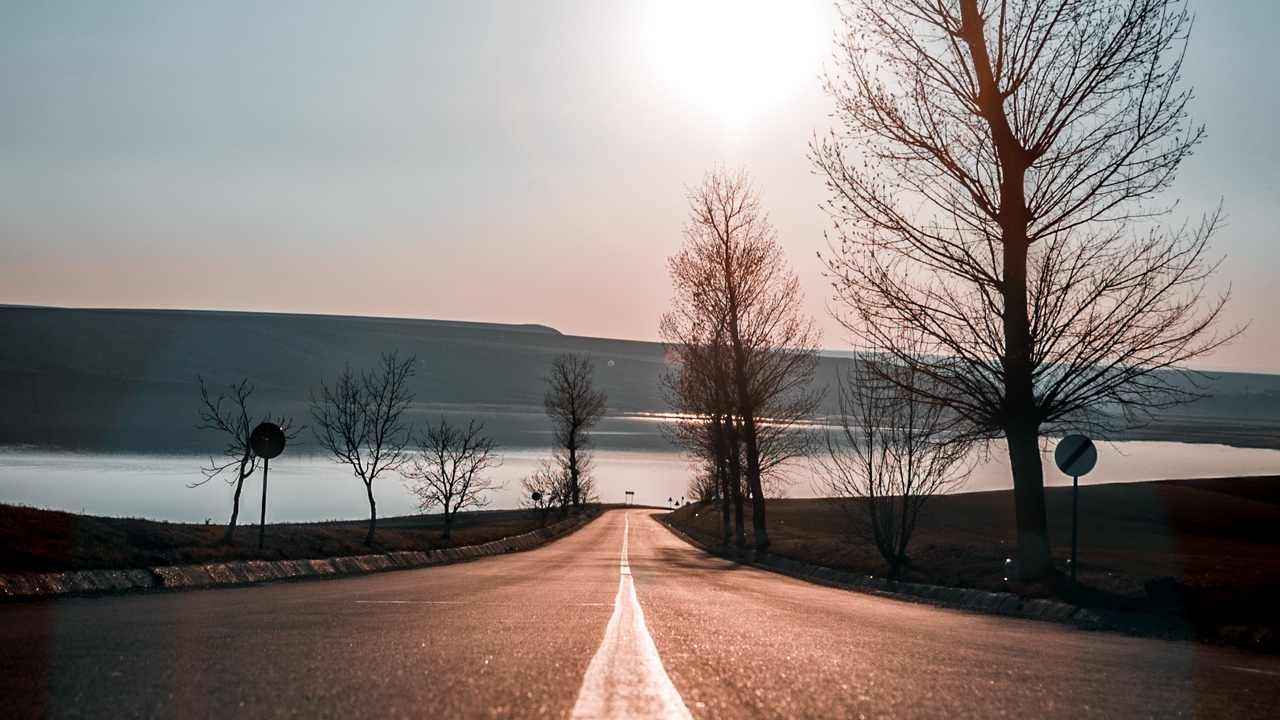 Preview wallpaper direction, road, sky, sunset, trees