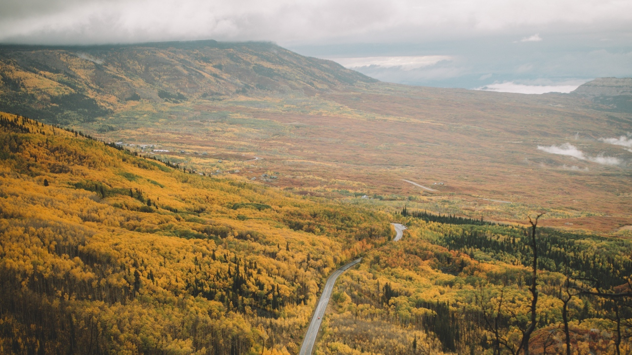 Preview wallpaper aerial view, forest, mountains, road, valley