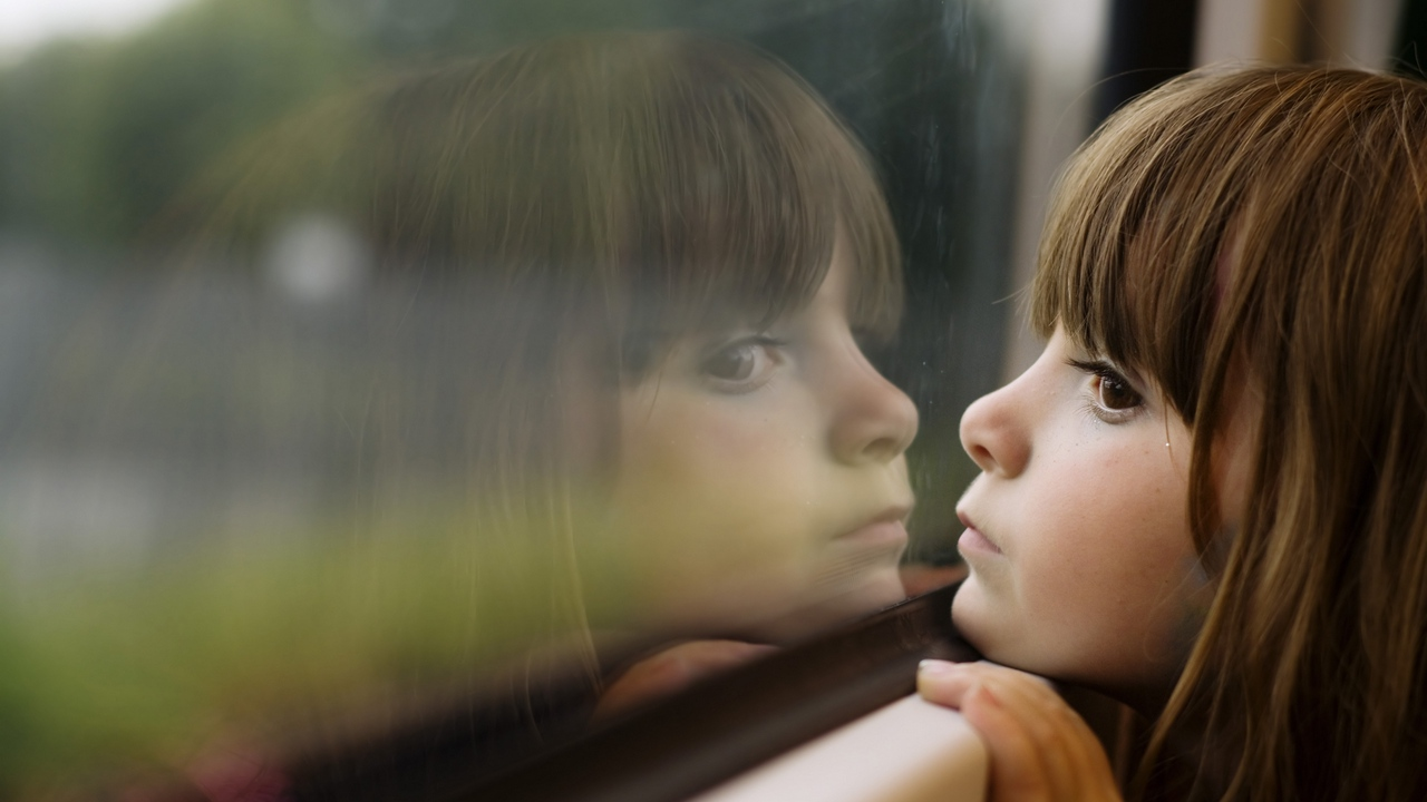 Preview wallpaper brown, face, girl, glass, sad, window