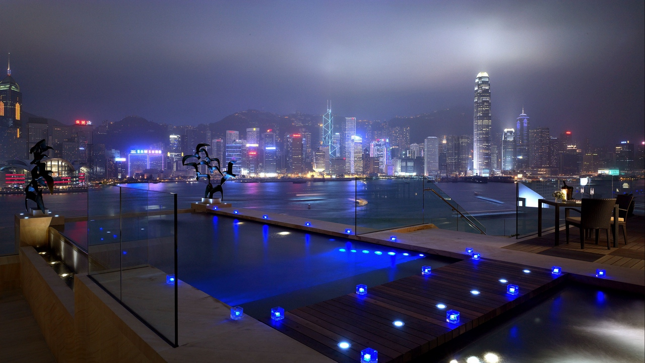 Preview wallpaper blue, city, houses, light, lights, night, pool, river, roads, skyscrapers, windows