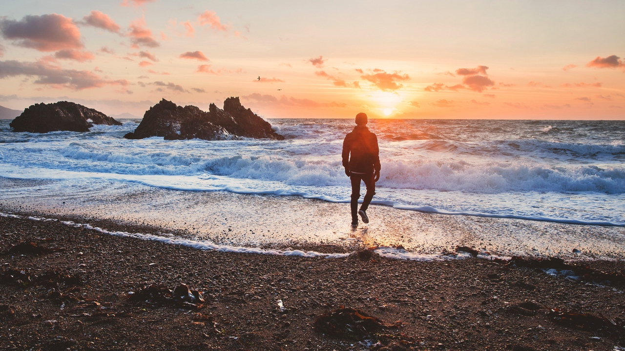 Preview wallpaper alone, man, sea, solitude, sunset, surf, united kingdom, wales