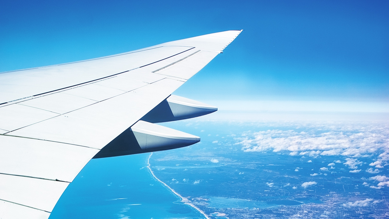 Preview wallpaper city, flight, ocean, plane, view from above, wing