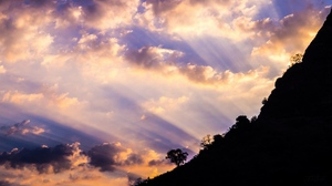 Preview wallpaper clouds, dawn, sky, slope, trees