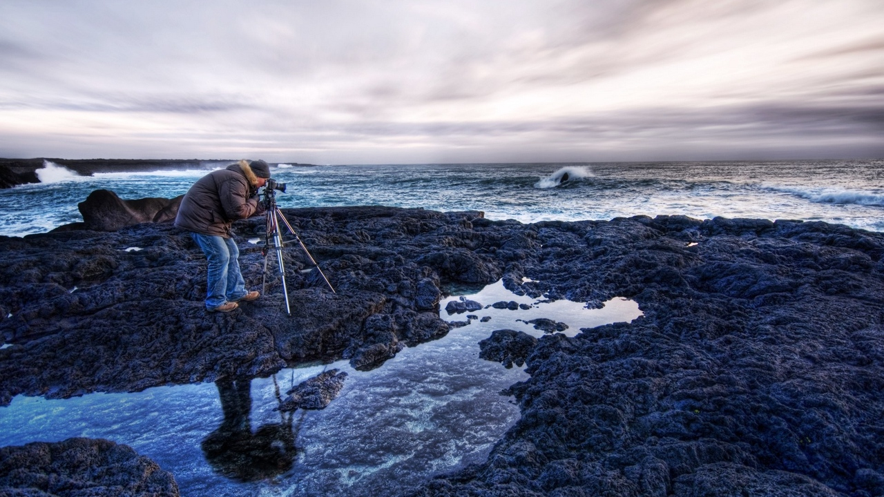 Preview wallpaper coast, cold, photographer, shooting, stones, support
