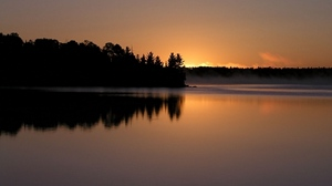 Preview wallpaper coast, decline, evening, outlines, sun, surface of the water, trees