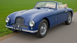Preview wallpaper 1951, aston martin, blue, cars, grass, houses, nature, side view, style, trees