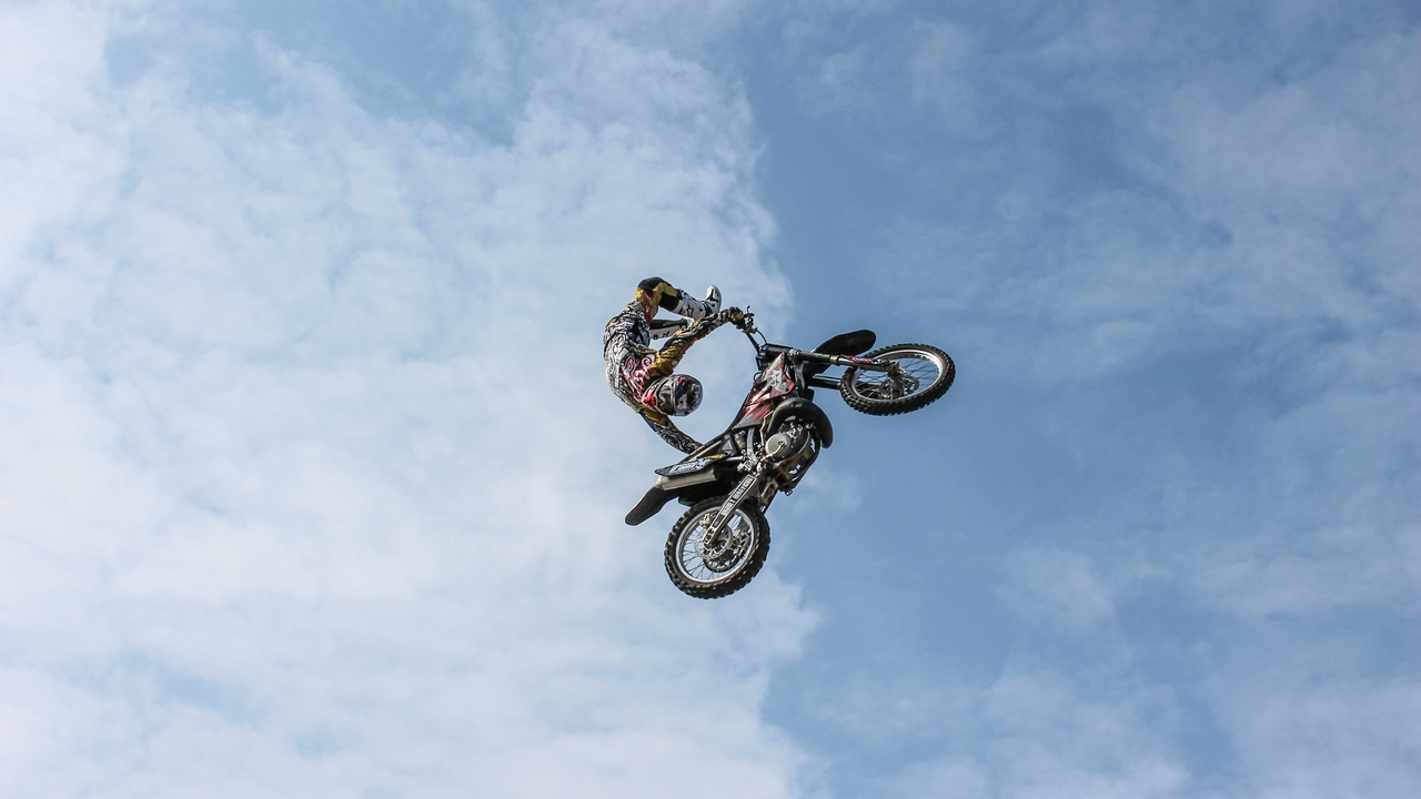clouds extreme sky biker trick motorcycle