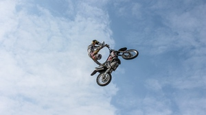 Preview wallpaper biker, clouds, extreme, motorcycle, sky, trick