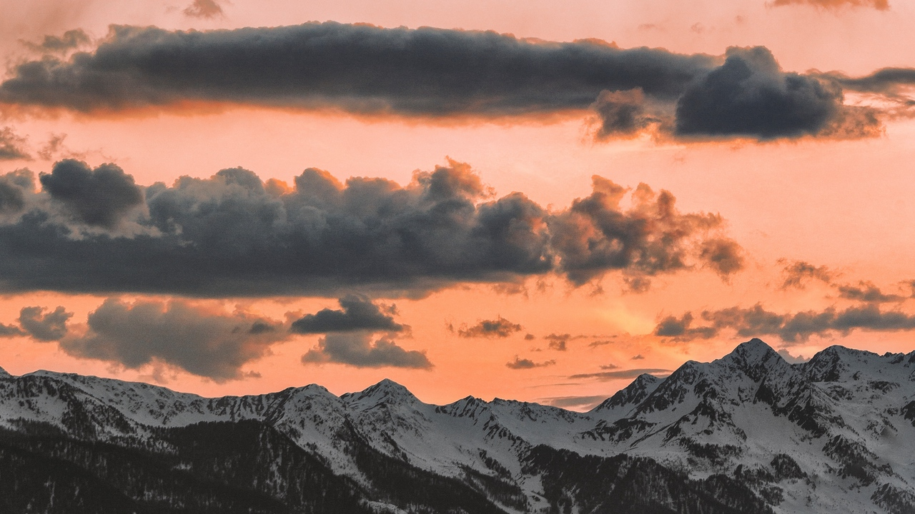 mountains sunset sky peaks porous clouds