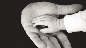 Preview wallpaper bw, caring, child, family, hands, parents, tenderness