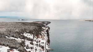 Preview wallpaper aerial view, buildings, coast, island, snow