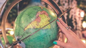 Preview wallpaper globe, hand, map