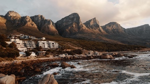 Preview wallpaper buildings, coast, mountains, rocks, water