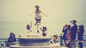 Preview wallpaper beach, company, girl, jump, people, photograph, street