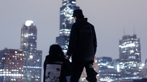 Preview wallpaper couple, love, night city, overview, roof, skyscrapers