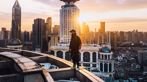 Preview wallpaper architecture, city, loneliness, man, roof, solitude, sunset